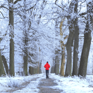 A man walking in the woods during winter