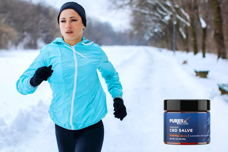 A woman running in the snow